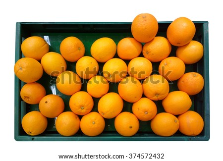 Top view of tasty spanish oranges freshly collected on a wooden box - stock photo