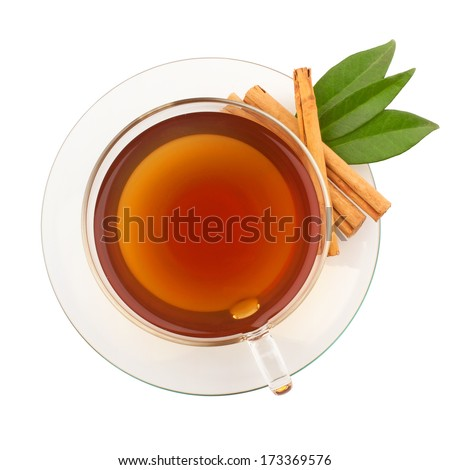 Top view of tea with cinnamon in glass cup - stock photo