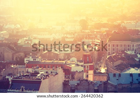 Top view of the city at sunset, Lviv, Ukraine. Color toning effect has been applied. - stock photo