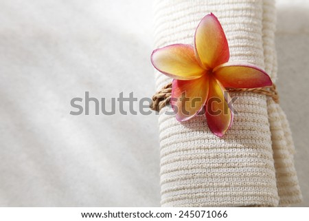 top view of the frangipani flower on hand towel - stock photo