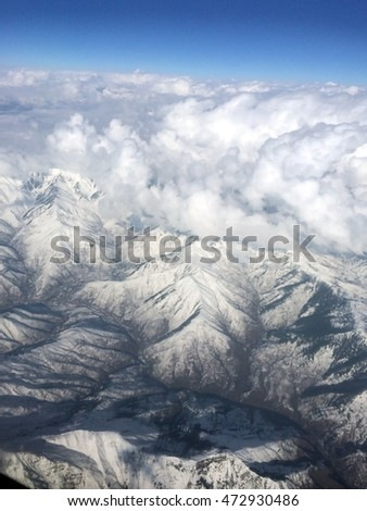 Top view of the highest mountain. Himalaya is covered with snow and cloud.