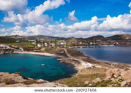 Top view of the Kalafatis beach of Mykonos against a beautiful sky with clouds. Greece. - stock photo
