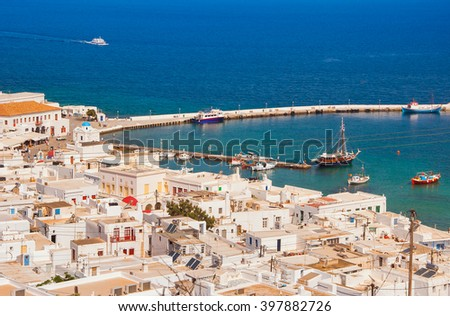 Top view of the town and the old port of Mykonos island. - stock photo