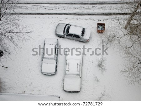top view of three cars in heavy show - stock photo