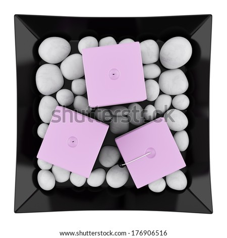 top view of three purple candles on dish isolated on white background