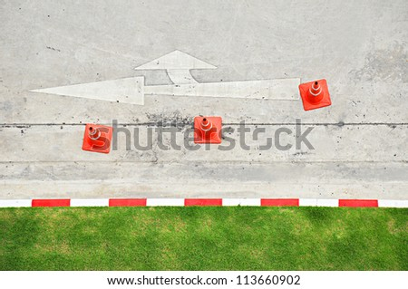 Top view of traffic signs and cones on concrete street - stock photo
