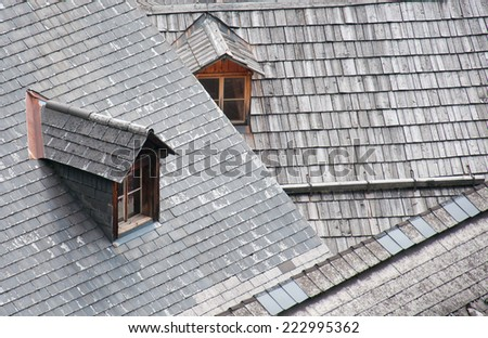 top view of two wooden dormers on a wooden roof - stock photo