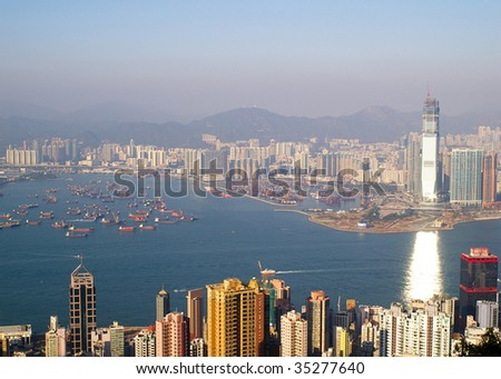 Top View of Victoria Harbor and West Kowloon from the Peak, Hong Kong - stock photo