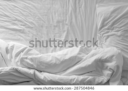 Top view of white bedding sheets and pillow - stock photo