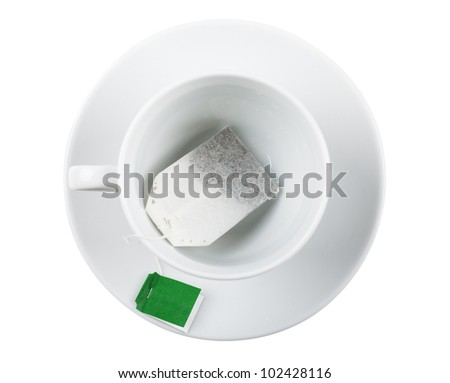Top view of white cup with teabag over white background - stock photo