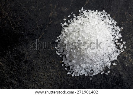 top view of white salt on black table - stock photo