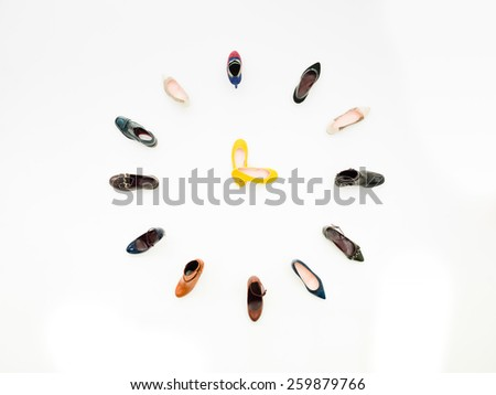 top view of women shoes arranged in clock shape, isolated on white background - stock photo