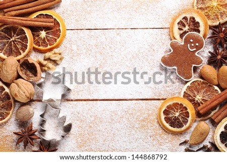 Top view of wooden board with Christmas baking ingredients. - stock photo