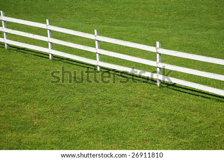 Top view of wooden fence on a green lawn - stock photo