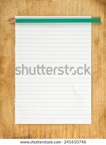 Top View of Writing Notes concept, graphite pencil and piece of blank paper as copy space on wooden table. - stock photo