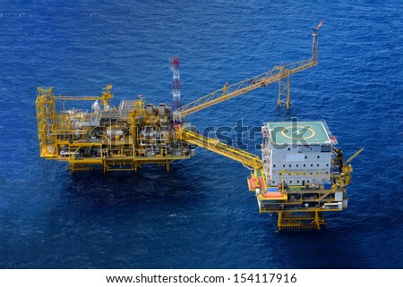 Top view offshore oil rig platform - stock photo