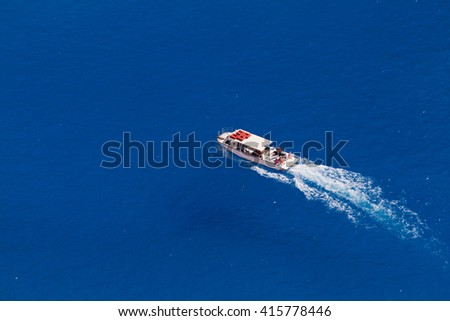 Top view on a  boat in azure water - stock photo