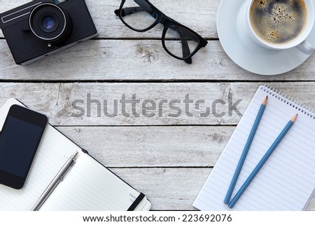 Top view on a table in the workplace with coffee - stock photo