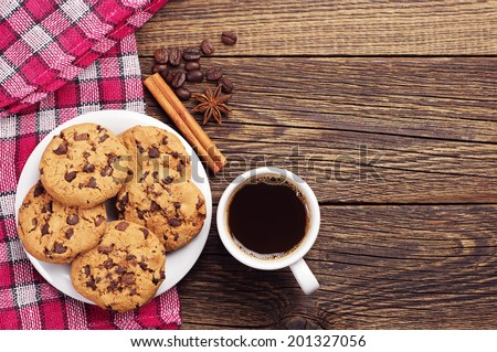 Top view on cup of coffee and plate with chocolate cookies - stock photo