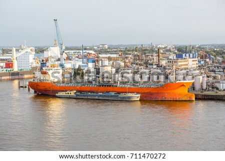 Top view on Elbe river with huge port of Hamburg city in Germany