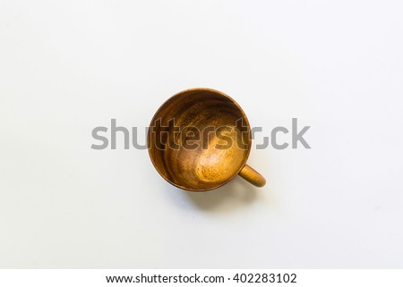Top view on empty wooden coffee or tea mug or cup. Studio shot from above on white background. - stock photo
