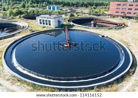 Top view on round form water treatment primary radial settler - stock photo