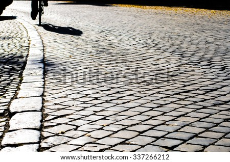 Top view on texture background of straight flat stony brick grey paving stone street road outdoor, horizontal picture - stock photo