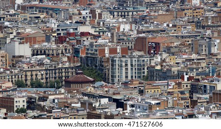 Top view over Barcelona houses roofs with old and new buildings, Spain, July 2016