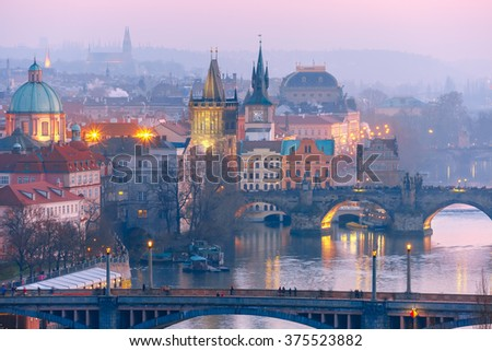 Top view over Old Town and bridges over Vltava River at night in Prague, Czech Republic - stock photo