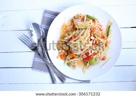Top view Papaya salad on white background - stock photo