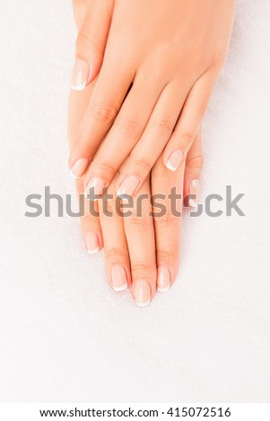 Top view photo of woman's hands with perfect manicure