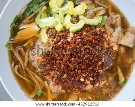 Top view pile of red cayenne pepper in the noodle bowl, cook the noodles. - stock photo