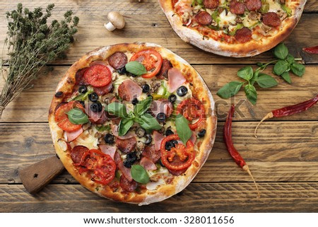 top view pizza margherita with ham pepperoni and tomato slice on rustic table - stock photo