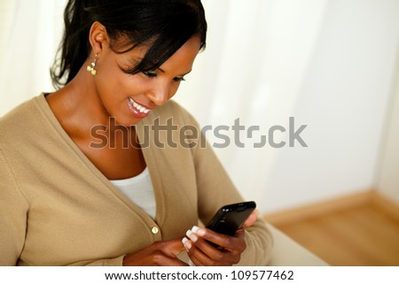 Top view portrait of a charming adult girl reading a message on cellphone - stock photo