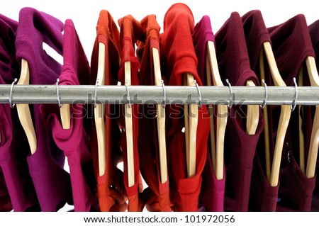 Top view rack colorful shirts - stock photo