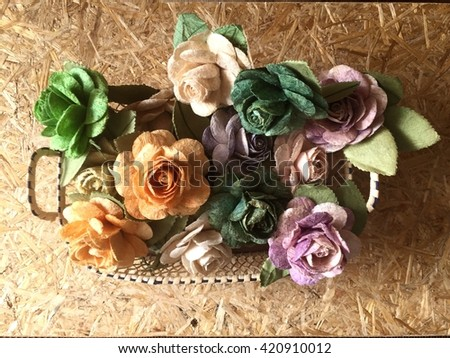 Top view rose flowers in mulberry paper in basket with lighting at morning - stock photo