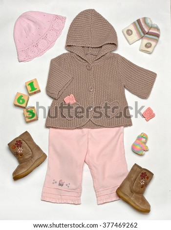 top view set of fashion warm trendy clothes and kids stuff for little  baby, fashion concept