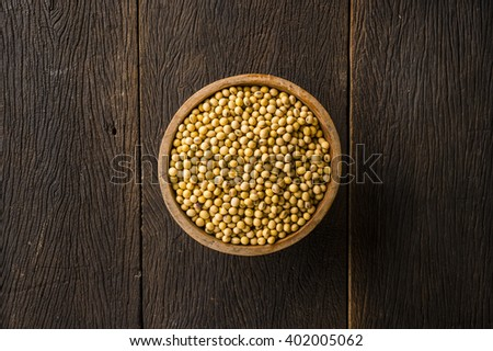 Top view soy bean in wood bowl on table - stock photo