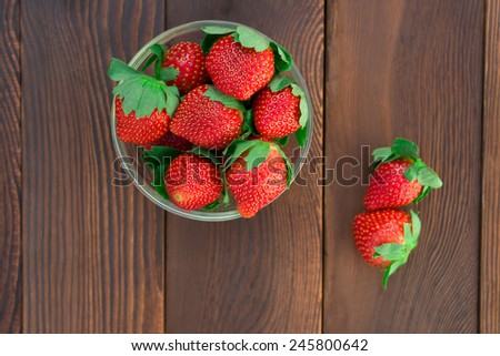 top view strawberries on wood - stock photo