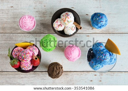 Top view strawberry, blueberry and vanilla ice cream in bowl on white rustic wooden background. - stock photo