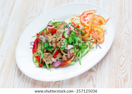 Top view - Thai style roast beef with salad and Chili Sauce - stock photo