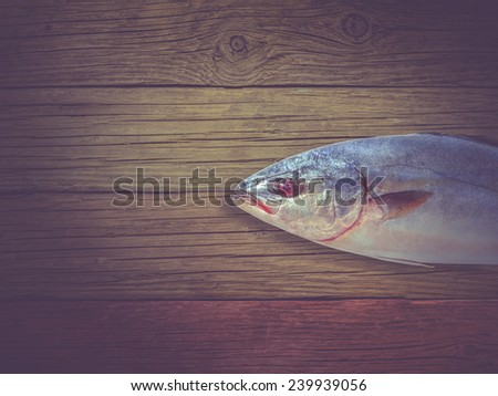 Top view The amberjack on old wooden Process is still life with vintage style - stock photo