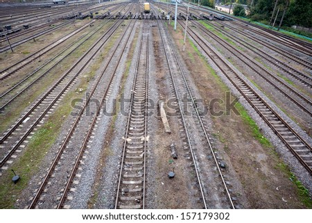 top view to a lot of parallel railway lines at marshalling yard - stock photo
