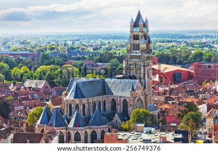Top view to Bruges and the cathedral St. Sauveur, the oldest brick church of Belgium - stock photo