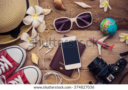 Top view travel accessories for summer on wooden background - stock photo