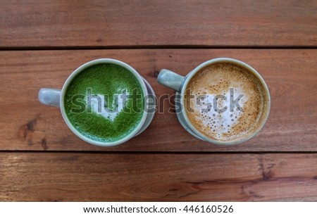 Top view two cups of coffee and matcha green tea on wooden - stock photo