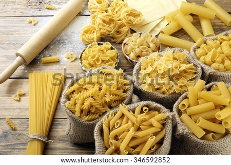 top view Various types of Italian pasta  rustic background - stock photo