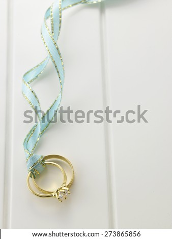 Top view Wedding rings connected with green ribbon - stock photo