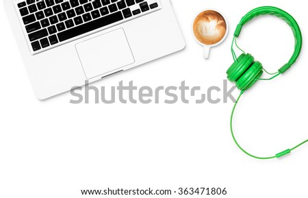 Top view white work space with computer coffee headphones