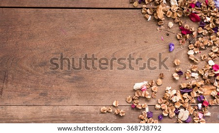 Top view workspace with dried flowers on wooden table background .Free space for your text. - stock photo